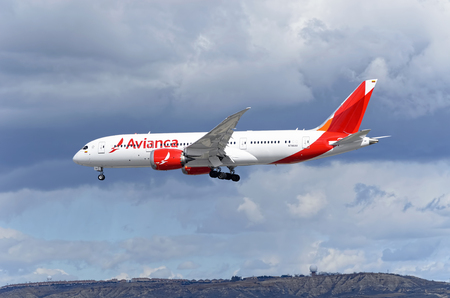twin engine: MADRID, SPAIN - MARCH 05th 2016: Passenger jet aircraft -Boeing 787-8 Dreamliner-, of -Avianca- airline, is coming, ready to land, to Madrid Barajas airport (Spain), on March 05th 2016. Photo 3 of 5. Editorial