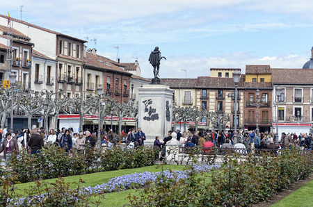 centenary: ALCALA DE HENARES, SPAIN - APRIL 23th 2016: Unknown people are walking by Cervantes square, during 4th centenary of Miguel de Cervantess death, in Alcala de Henares, on April 23th 2016. Today, many cultural activities around the writer of  -Don Quixote