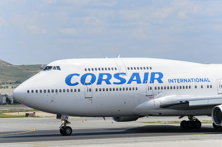 corsair: MADRID, SPAIN - MAY 15th 2016: Commercial aircraft -Boeing 747-, of -Corsair International- airline, is ready to take off from Madrid-Barajas -Adolfo Suarez- airport, on May 15th 2016.