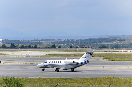 cessna: MADRID, SPAIN - MAY 15th 2016: Private jet -Cessna 525A CitationJet CJ2-, of -Sylt Air GmbH- airline, is going direction to runway, ready to take off from Madrid-Barajas -Adolfo Suarez- airport, on May 15th 2016.
