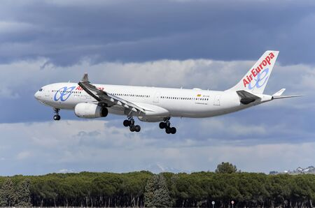 jumbo jet: MADRID, SPAIN - MARCH 05th 2016: Jumbo jet airliner -Airbus A330-, of -Air Europa- airline, is landing in Madrid Barajas airport (Spain), on March 05th 2016.