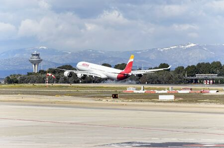 barajas: MADRID, SPAIN - MARCH 05th 2016: Airliner -Airbus A340-, of spanish airline -Iberia-, is landing in Madrid Barajas airport (Spain), on March 05th 2016.