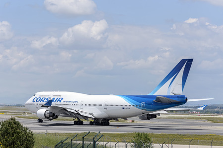corsair: MADRID, SPAIN - MAY 15th 2016: Plane -Boeing 747-, of -Corsair International- airline, direction to runway of Madrid-Barajas -Adolfo Suarez- airport, ready to take off, on May 15th 2016. Editorial