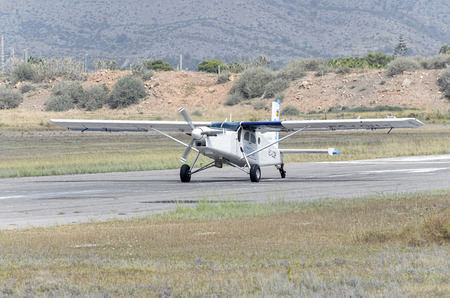parachutists: CASTELLON, SPAIN - AUGUST 1th 2016: Small plane Pilatus PC-6B2-H4 Turbo Porter, landing in Castellon de la Planas airfield, on August 1th 2016, after the parachutists have jumped. Cloudy day.
