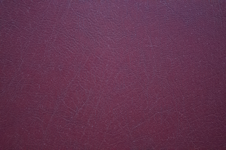 Dark purple leather texture surface for background.