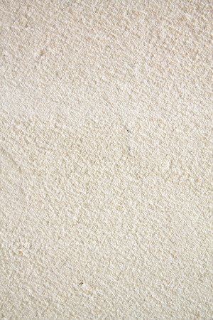 Cream colored blank concrete wall for texture background.