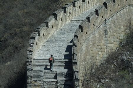 greatwall: A traveler walk toward to the top of greatwall.
