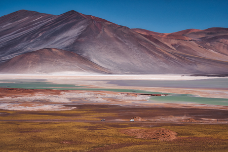 The salt pans at Salar de Talar in the Chilean Andes in the Atacama desert with rugged barren mountain peaks