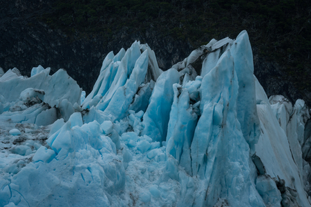 Sharp peaks and pieces of blue ice of glacier in close-up. Patagonia, Argentina Stock Photo
