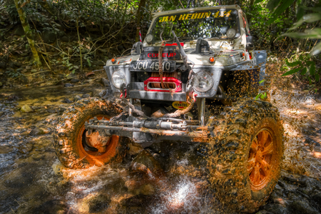 KELANTAN, MALAYSIA - NOVEMBER 2018 : 4x4 vehicle negotiating mud and water while competing in the Rainforest Challenge in Kelantan, Malaysia Editorial