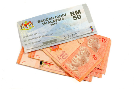 1malaysia: Kuala Lumpur, Malaysia - April 19, 2015: The 1Malaysia Book Voucher or Baucar Buku 1Malaysia (BB1M) is an initiative by the Ministry of Higher Education (MOHE) in 2012 to help ease the financial burden of tertiary students all over Malaysia Editorial