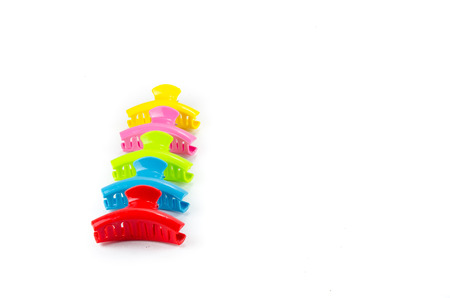 Plastic hair clips isolated on white background photo