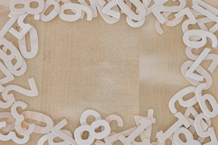 Wooden number frame with soft brown wood background. Copy space for text or advertisement.