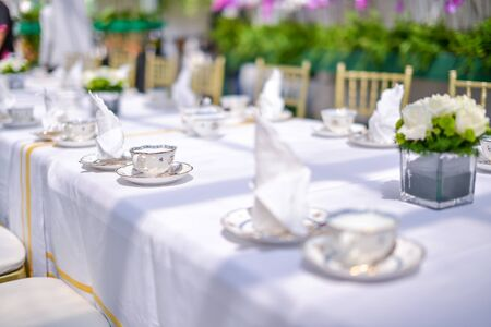 Vintage english style hi tea table decoration. Shallow DOF with selective focus on the cup. Stock Photo