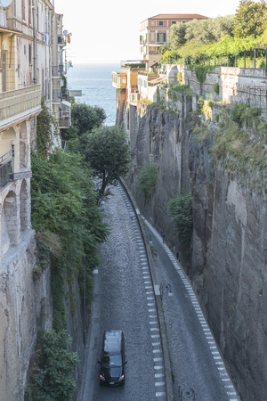 abrupt: Italy. Sorrento. The narrow highway among the rocks to the sea