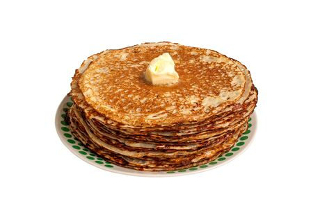 rationale: Roasted delicious pancakes and a piece of butter. White background