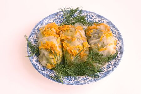 high calorie foods: Cookery. High-calorie dish. Meat with cabbage. Carrots and green fennel