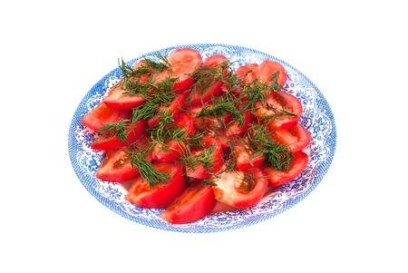 finocchio: Pomodori rossi e finocchio verde su un piatto