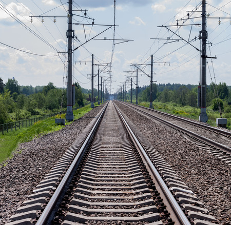 cross ties: Direct railroad tracks and support with electric wires Stock Photo
