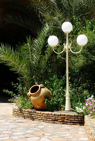 garden lamp: Tall lamp and barrel in green garden