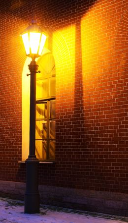 Standalone Lamp and brick wall in twilight photo