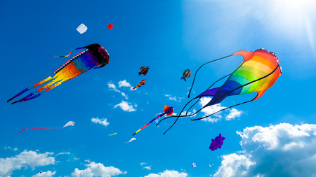 kite flying: Various kites flying on the blue sky in the kite festival Stock Photo