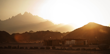 Bedouin village in desert in mountains in sunset
