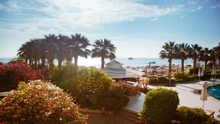 hotel exterior: Luxury hotel exterior and beach of sea in the bright day in Egypt