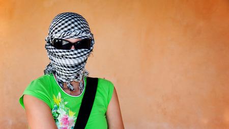 keffiyeh: White woman in keffiyeh and sunglasses before safari Stock Photo
