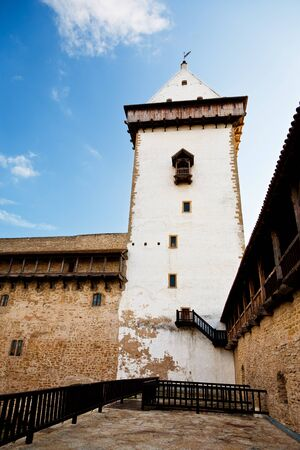 herman: Courtyard with tall tower in castle of Herman in Narva
