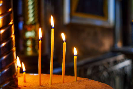 lighted: Interior with lighted candles for prey in orthodox cathedral