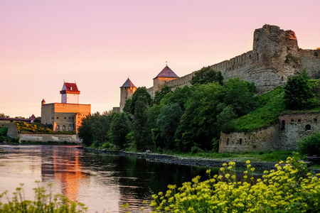 herman: Ivangorod fortress and Castle of Herman during sunrise Stock Photo