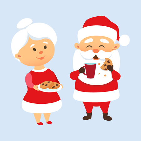Santa Claus eating a cookies and drinking milk with his wife. Mrs. Santa Claus treat and feed Mr. Santa Clause cookies. Christmas tradition. Cute Santa Claus family couple. Mother and Father Christmas