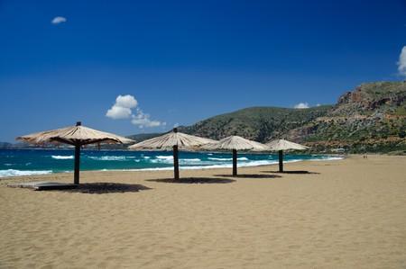 During April beach of Agios Nikolaos in Crete is almost empty. Фото со стока