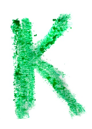 K letter painted on a white background   photo