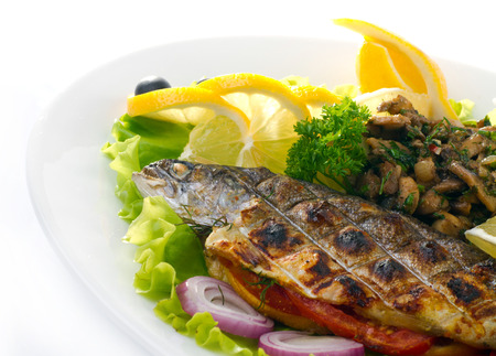 rainbow fish: Grilled trout with lime and salad isolated on white Stock Photo