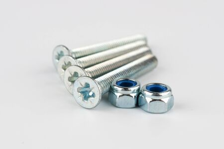 Two shiny metal nuts and bolts Stock Photo - 17251721
