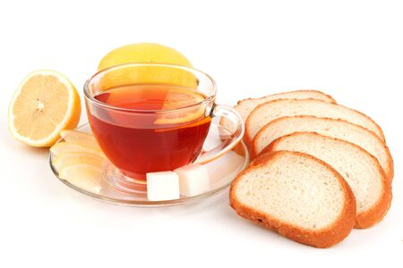 Glass cup of tea with lemon and slices of white bread Stock Photo - 17251733