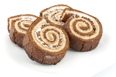 Four chocolate roll on a white plate