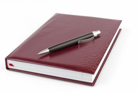 Black ballpoint pen on the leather cover diary photo