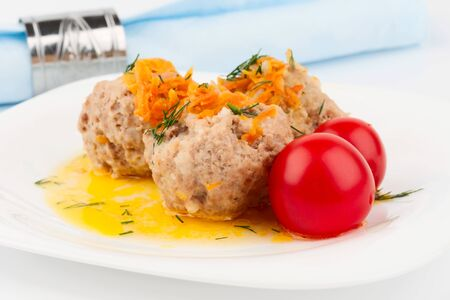 Meatballs on a white plate with cherry tomatoes Stock Photo