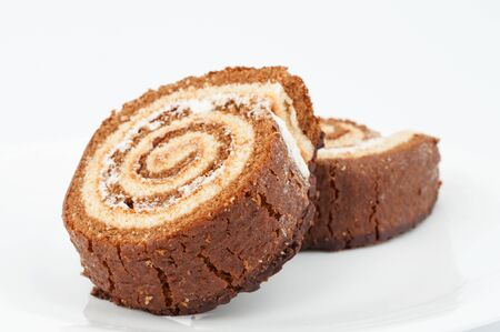 Two chocolate cake roll on white background