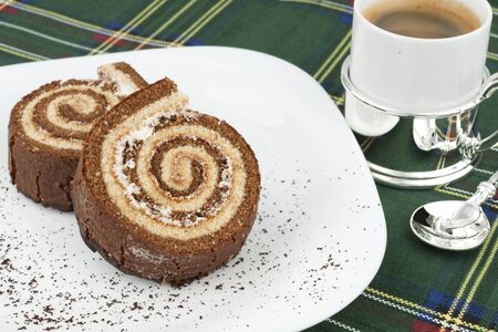 Two chocolate roll on a white plate Stock Photo