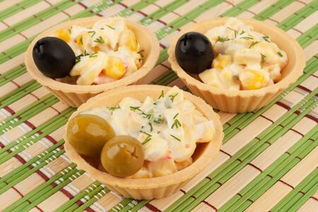 Tartlets with crab salad and olives