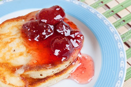 Flour pancakes with strawberry jam