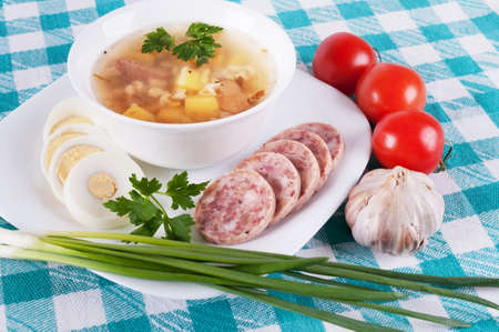 Soup and a variety of vegetables on colored tablecloths photo