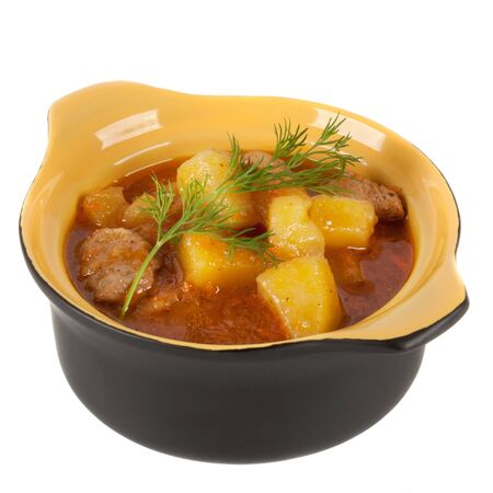 Stewed potatoes in a pot on a white background