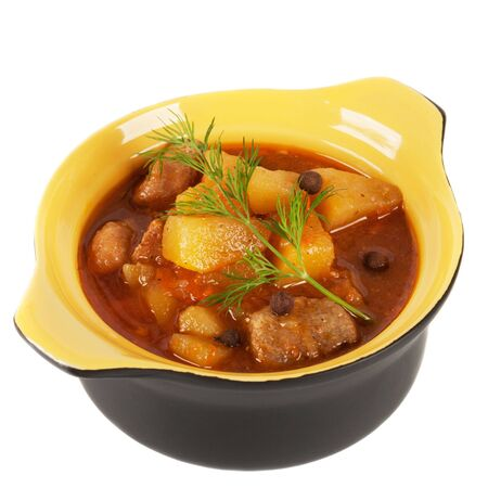 Black clay pot with braised potatoes  On a white background