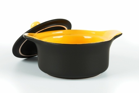 Ceramic pot for baking with the lid open  On a white background