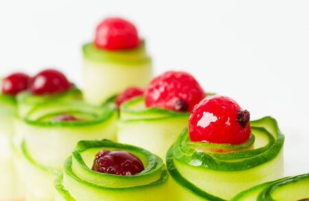 Cucumber rolls with frozen cranberries  Close up